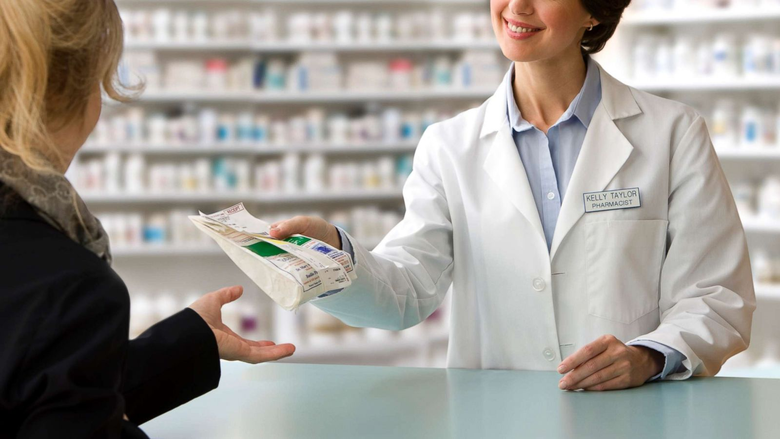 pharmacist-helping-patient